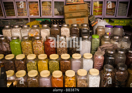 sweets, spices and herbs for sale - Stock Photo