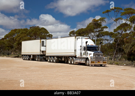 Road Train parked up traveling on the Eyre Highway in South Australia - Stock Photo