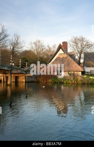 Cottage & bridge on the River Stour at Flatford in Suffolk on a spring day - Stock Photo
