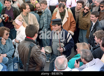 People from West Berlin with Berlin Wall pieces in 1989, Berlin, Germany - Stock Photo