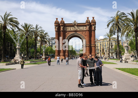 Tourists in front of Arc de Triomf in Barcelona, Spain - Stock Photo