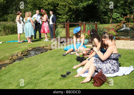 guests relaxing at wedding reception - Stock Photo
