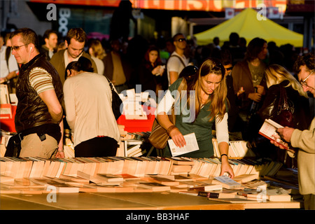 a woman browsing books at a book stall on the thames southbank - Stock Photo