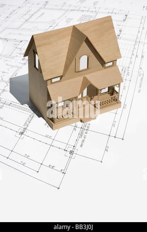 Model of two storey house on set of blueprints - Stock Photo