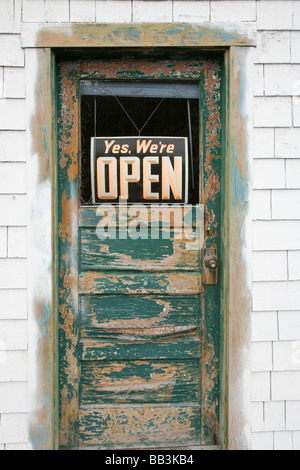 USA, Alaska, Elfin Cove. Open sign on worn shop door. - Stock Photo