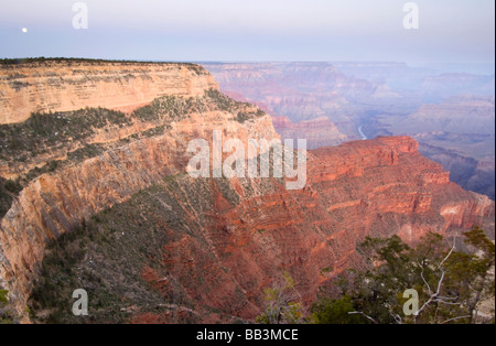 USA, AZ, Grand Canyon NP, Full Moon Setting Over the Grand Canyon from Hopi Point - Stock Photo