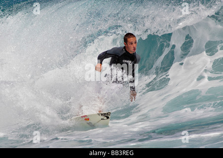 Surfer riding a wave off Ho okipa Beach Maui USA - Stock Photo