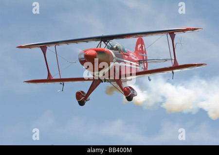 Oracle Challenger II Stunt Biplane trailing with smoke in the air. (Not available as 2017 calendar cover) - Stock Photo