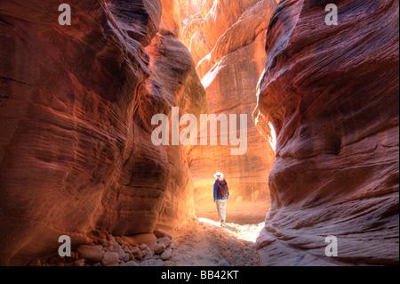 Utah Paria Canyon-Vermillion Cliffs Wilderness Buckskin Gulch 21 mile long slot canyon Hiker in narrow slot of Buckskin - Stock Photo