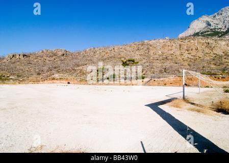 Greek Island Karpathos: Soccerfield in poor landscape. - Stock Photo