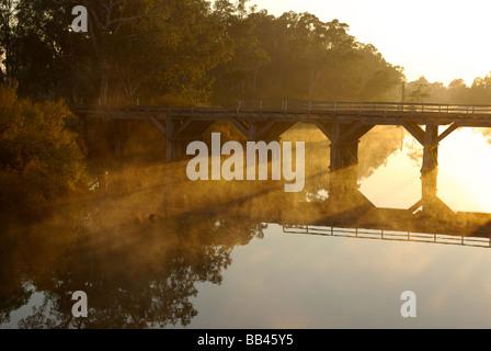 Chinaman's Bridge across the Goulburn River, near Nagambie, Victoria, Australia shortly after sunrise. - Stock Photo
