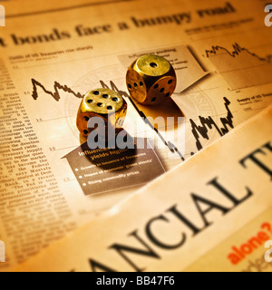 PAIR OF DICE ON FINANCIAL TIMES NEWSPAPER - Stock Photo