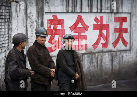 Workers chat at a chinese coal mine, Liulin, Shanxi, China. - Stock Photo