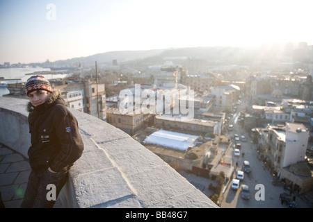 Teenage boy with view over Baku, Azerbaijan - Stock Photo