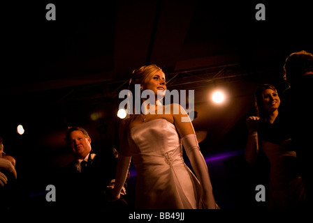 A debutante glances back at the audience during her father- daughter waltz at a debutante ball in La Jolla, California. - Stock Photo