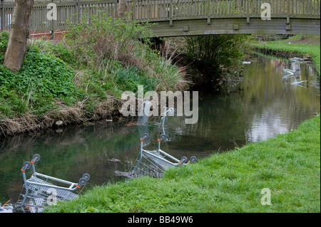 Discarded shopping trolleys littering a river in a city centre in England - Stock Photo