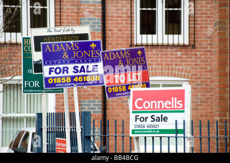 For sale and to let signs outside a property in a city centre in England - Stock Photo