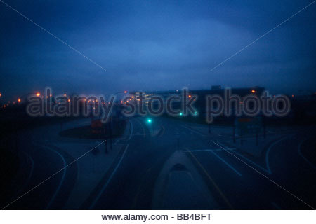 Dark and empty streets lead into Newark International Airport in New Jersey, just outside of Manhattan, New York. - Stock Photo