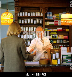 PHARMACIST WITH WOMAN CUSTOMER - Stock Photo