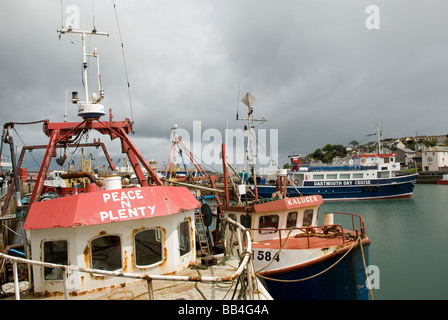 The Trawlers Peace n plenty and Kaluger in Brixham harbour in Torbay South Devon with the Dartmouth Bay Cruiser. - Stock Photo