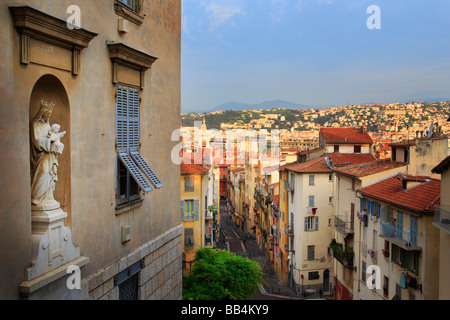 Statue of Mother Mary and the Jesus Child overlooking old town Nice in France - Stock Photo