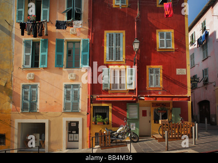 Typical French windows in the 'Vielle Ville' part of Nice, France - Stock Photo