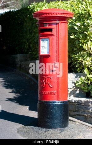 Round tall british Red mail box - Stock Photo