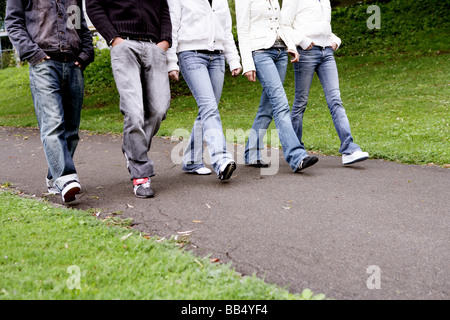 teenager group walking in park - Stock Photo