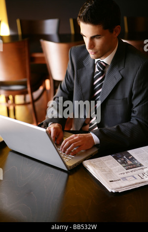 young man is working on a laptop - Stock Photo