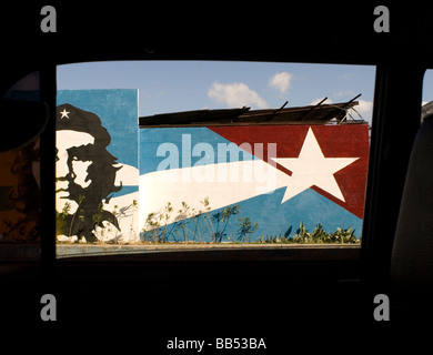 Mural of Ernesto Che Guevara framed by a car window in Havana Cuba. © Craig M. Eisenberg - Stock Photo