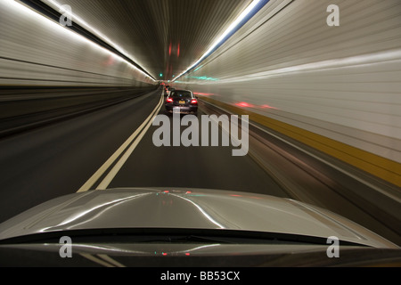 Passenger cars heading towards New York City in the Holland Tunnel, New Jersey. / © Craig M. Eisenberg - Stock Photo
