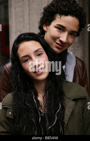 Portrait of teenager couple in the city - Stock Photo