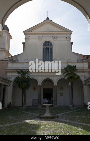 Court and façade of the basilica di San Clemente al Laterano in Rome - Stock Photo