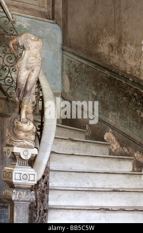 Ornate marble staircase to La Guarida Paladar Restaurant and statue in apartment building at Havana, Cuba, West - Stock Photo