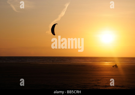 Lone kitebuggy at sunset - Stock Photo