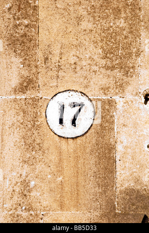 House number '17' painted on wall in Bath city, England, UK. - Stock Photo