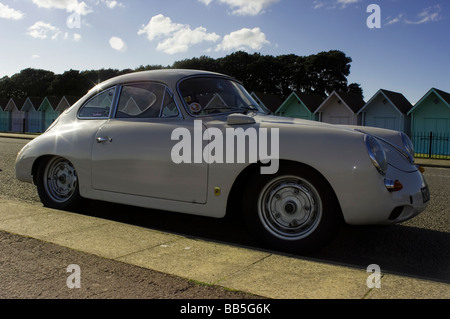 Vintage Car with beachuts in background - Stock Photo