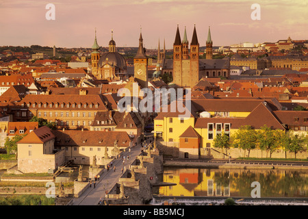 Town Hall tower St Kilian Cathedral and Alte Mainbrücke bridge at sunset in Würzburg Bavaria Germany - Stock Photo