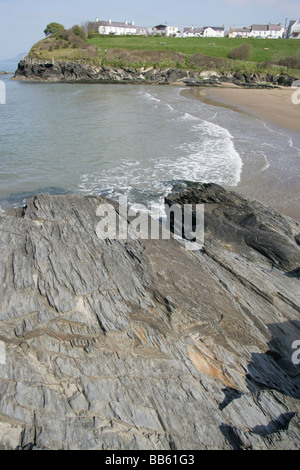 Village of Aberporth, Wales. Waves breaking on the east beach of Aberporth, with Pen Trwyn Cynwyl in the foreground. - Stock Photo