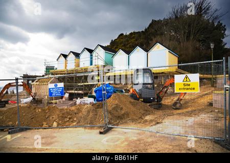 New beach huts and facilities being built at Alum Chine beach, Bournemouth, Dorset. UK. Nimbostratus clouds. - Stock Photo