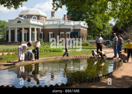 Mother & child playing in a small pond used to contain freshly caught fish at Monticello Thomas Jefferson s former - Stock Photo