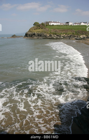 Village of Aberporth, Wales. Waves breaking on the east beach of Aberporth. - Stock Photo