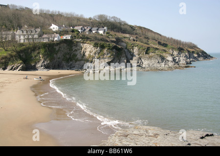 Village of Aberporth, Wales. Waves gently breaking on the west beach of Aberporth on a quiet sunny day. - Stock Photo