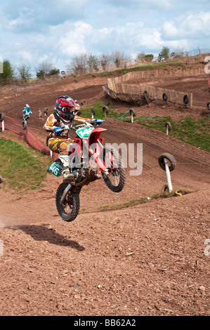 riders getting airborne during a Motocross race - Stock Photo