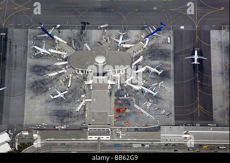 aerial view above Los Angeles International Airport LAX California terminal and taxiways - Stock Photo