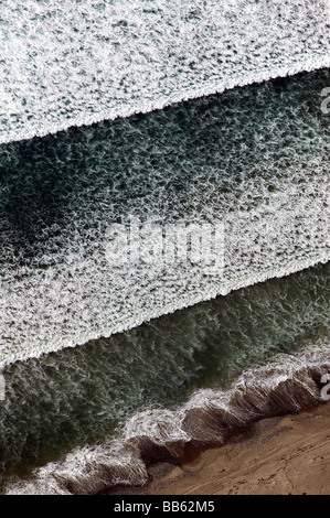 aerial view above Pacific Ocean surf waves California coast - Stock Photo