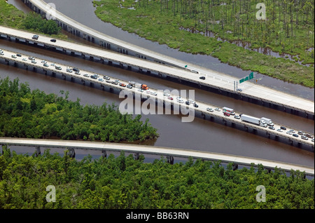 aerial view above heavy traffic leaving New Orleans Louisana metropolitan area on Interstate 10 crossing wetlands - Stock Photo