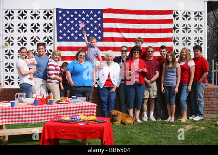 Large family group portrait at 4th of July Barbecue - Stock Photo