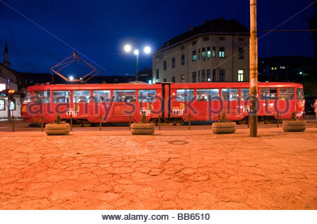 Tram passing through downtown Sarajevo capital of Bosnia Herzegovina - Stock Photo