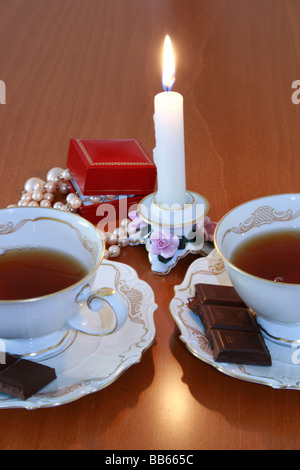 Gift -celebrating with candle for couple - Stock Photo